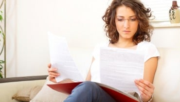 businesswoman at home doing paperwork