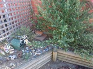 Raised garden beds against brickwork